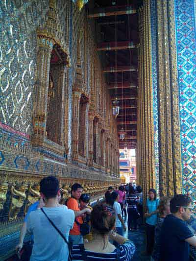 Crowds of tourists outside the Temple of the Emerald Buddha
