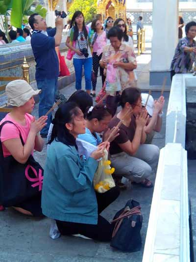 Prayers outside temple Emerald Buddha