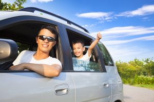 Happy Little Boy and Father travel by car