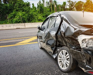 Will my car insurance or travel insurance cover me for a car accident in Malaysia?