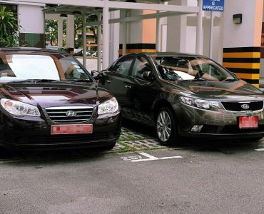 DirectAsia Insurance_Two black cars with red plates