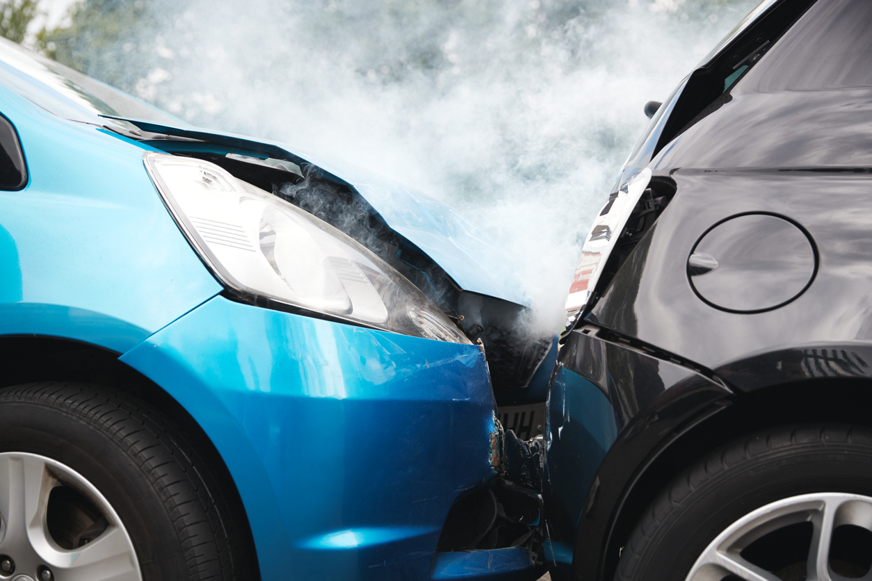 DirectAsia Insurance_a blue car hit the back of a black car, steam is seen