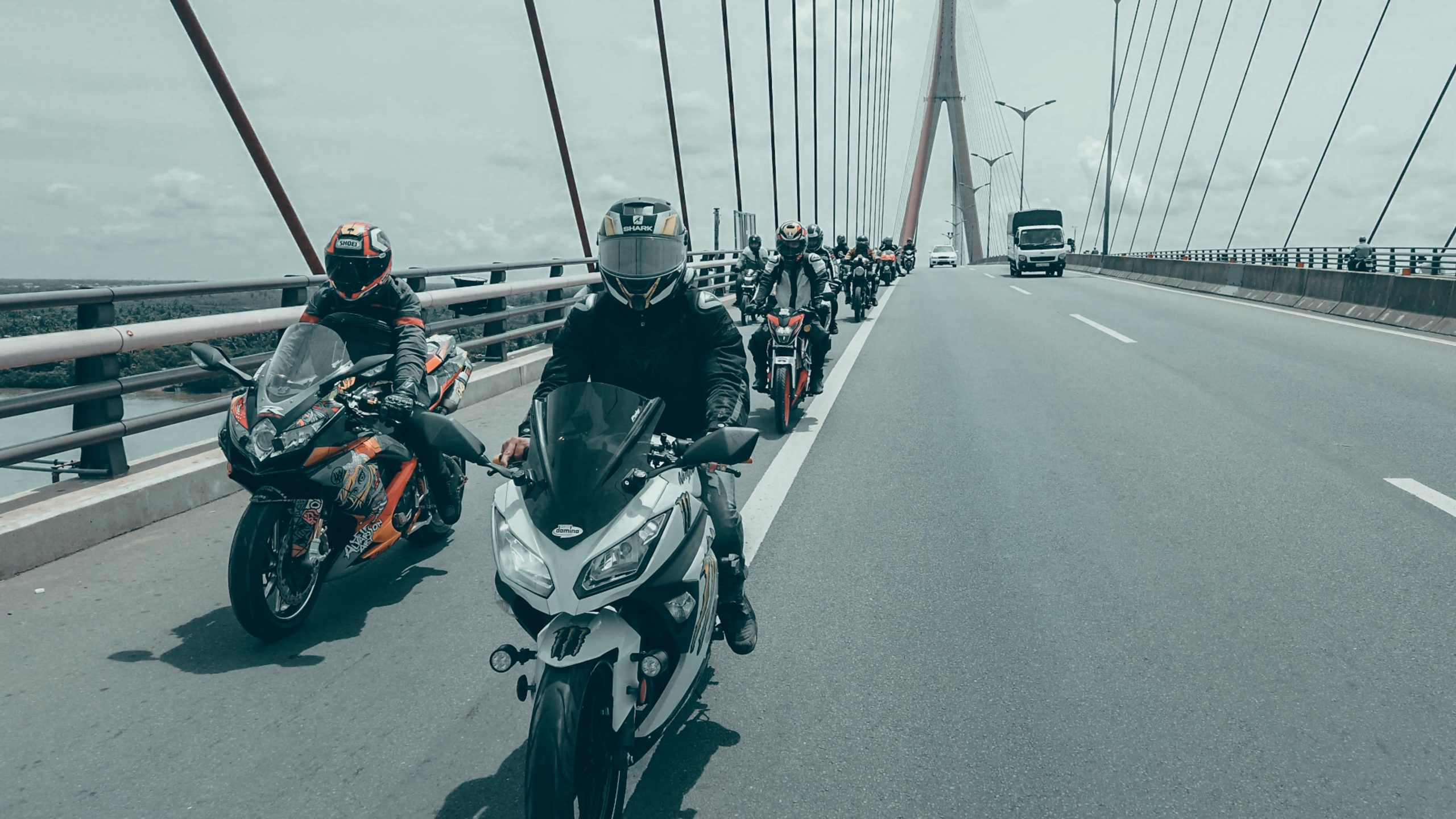 DirectAsia Insurance_Motorcyclists wearing helmets driving on the road