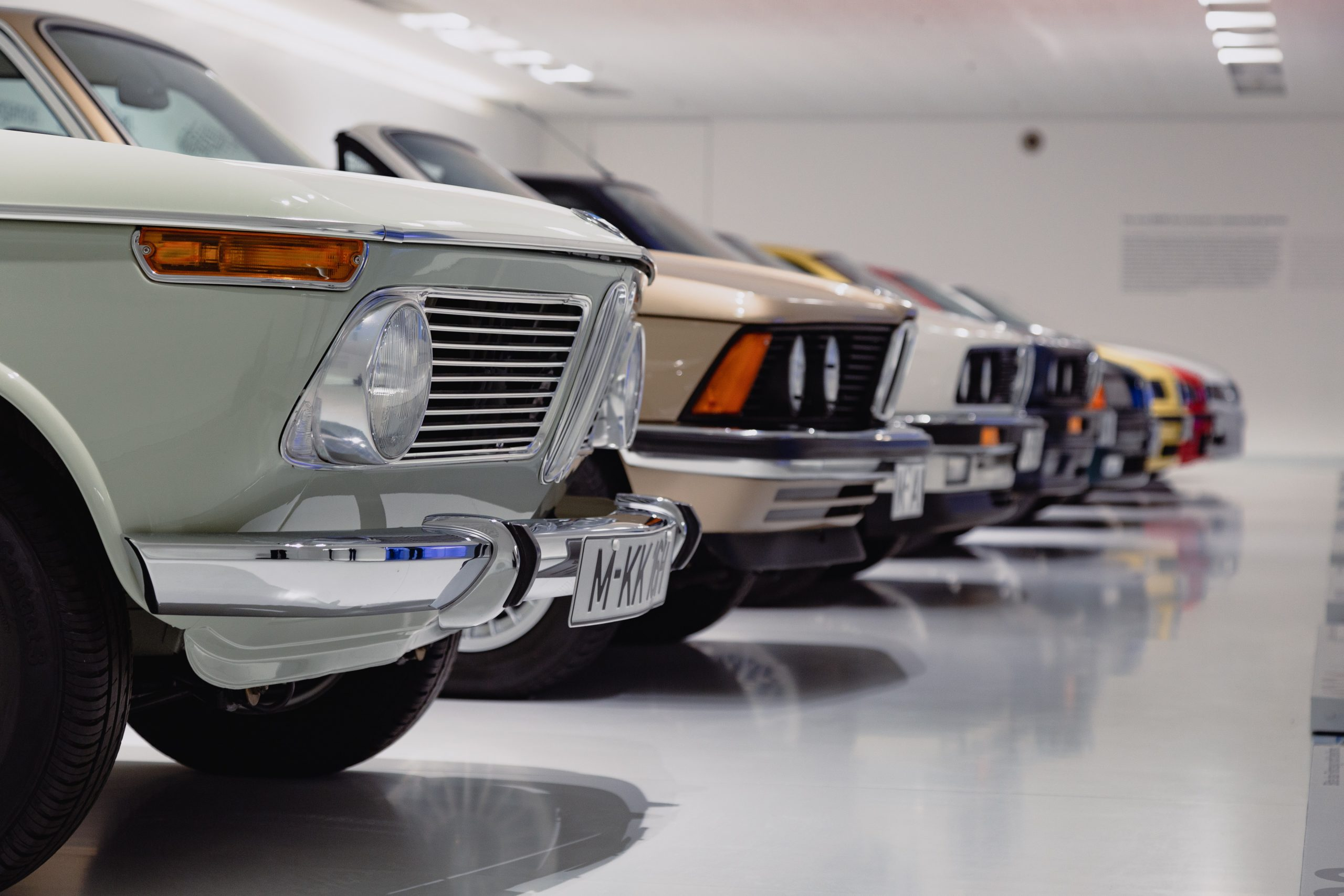 DirectAsia Insurance_A row of antique cars in a showroom