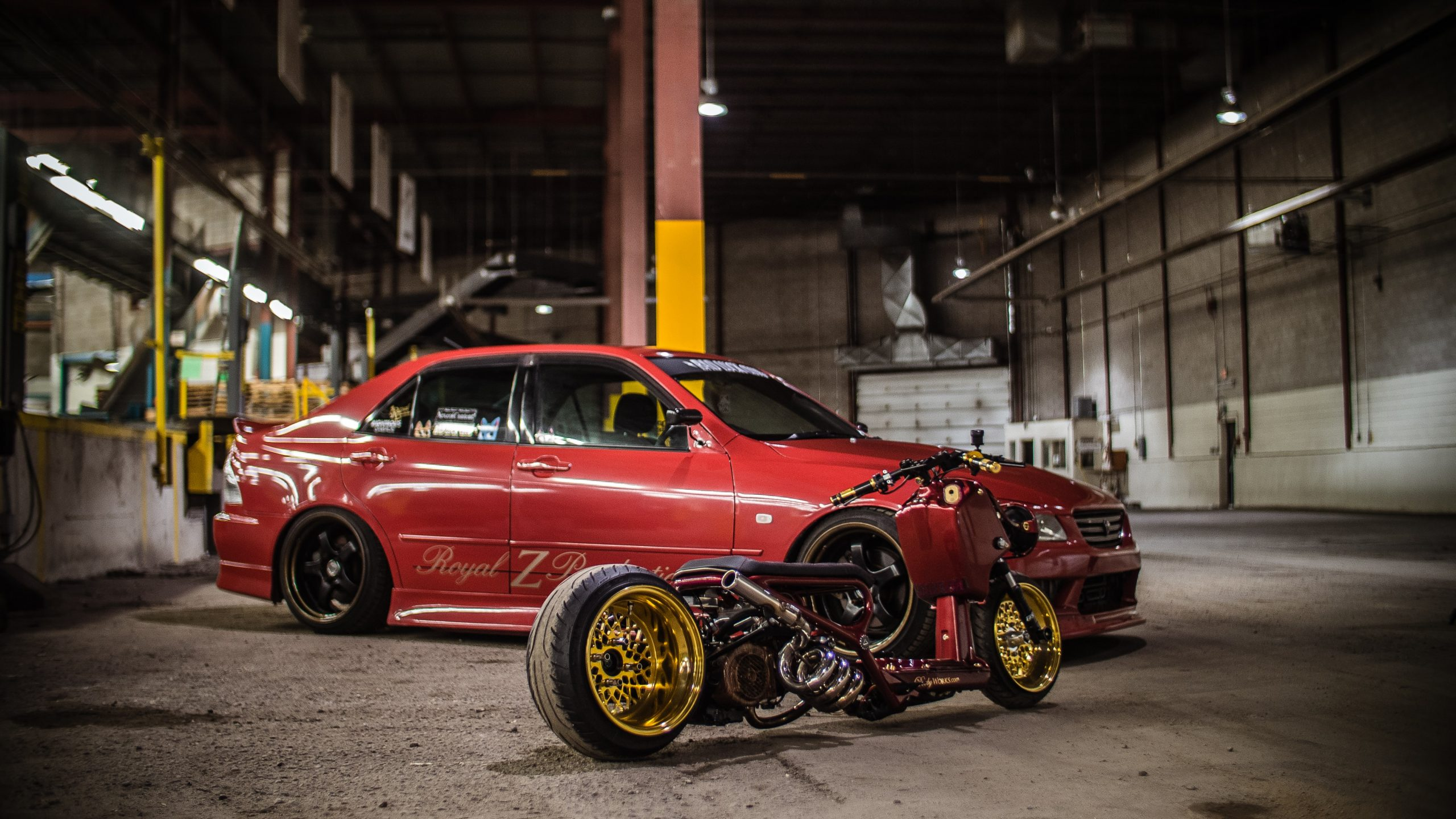 DirectAsia Insurance_A red car and a motorcycle placed together in a warehouse, like in a photoshoot