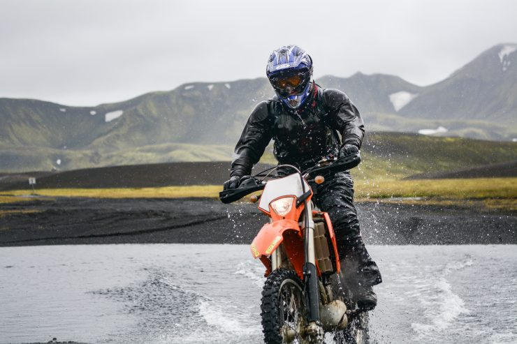 DirectAsia Insurance_motorcyclist on his bike riding on wet grounds