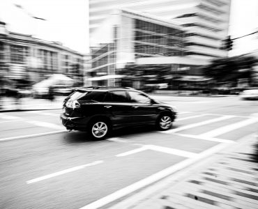 DirectAsia Insurance_A black car making a turn on the road