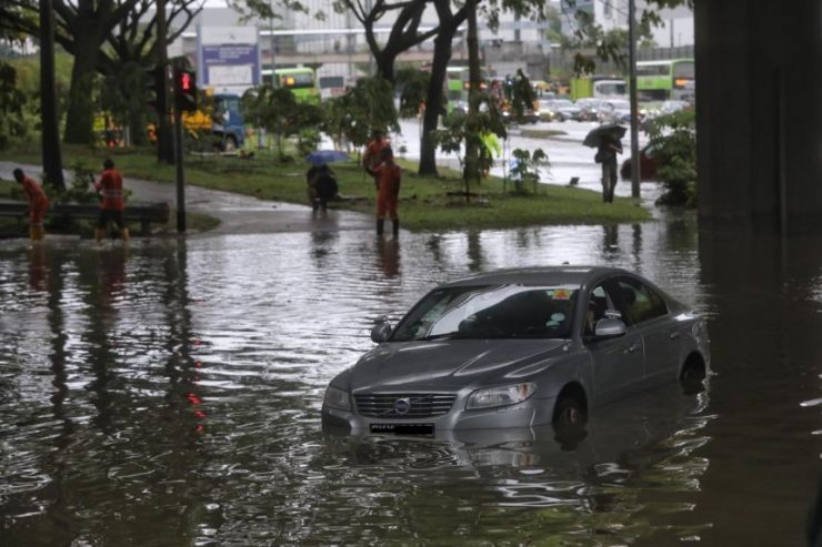 DirectAsia Insurance_A car partially submerged in a flood